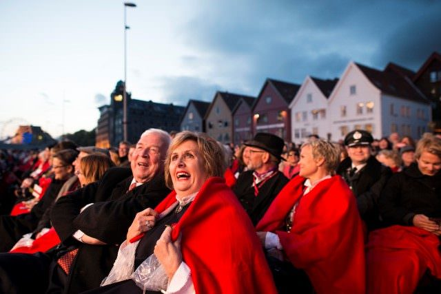 Viking Cruises' chairman Torstein Hagen and Bergen Mayor Trude Drevland take in the christening ceremonies in Bergen on Sunday, May 17, 2015 - Norwegian Constitution Day. Photo © 2015 Aaron Saunders