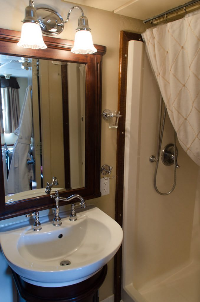 Bathrooms aboard the S.S. Legacy feature Victorian-style fixtures. Space is at a premium, but it's used well. The shower is unusually large for a ship of this size - a nice surprise! Photo © 2015 Aaron Saunders