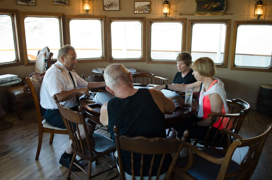 Captain Scott gets in on a friendly poker tournament in the Pesky Barnacle this afternoon! Photo © 2015 Aaron Saunders