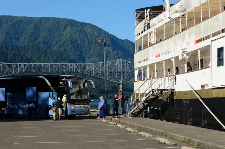 Guests disembark S.S. Legacy and board our luxury National Coach (locally-operated and based in Portland) for a day of touring ashore. Photo © 2015 Aaron Saunders