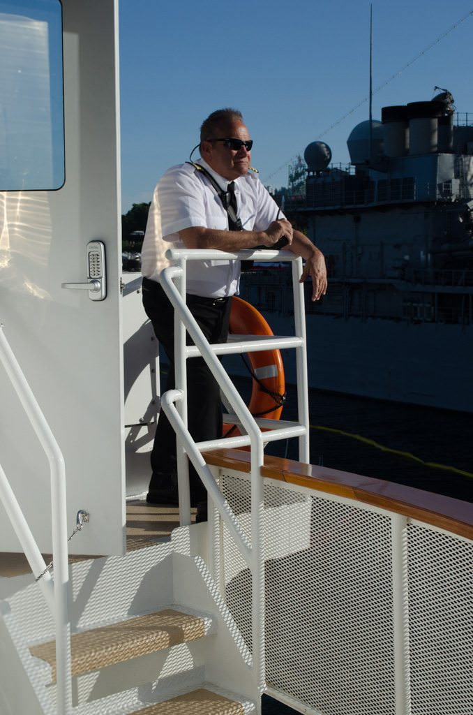 Captain Scott watches from the portside bridge wing...Photo © 2015 Aaron Saunders