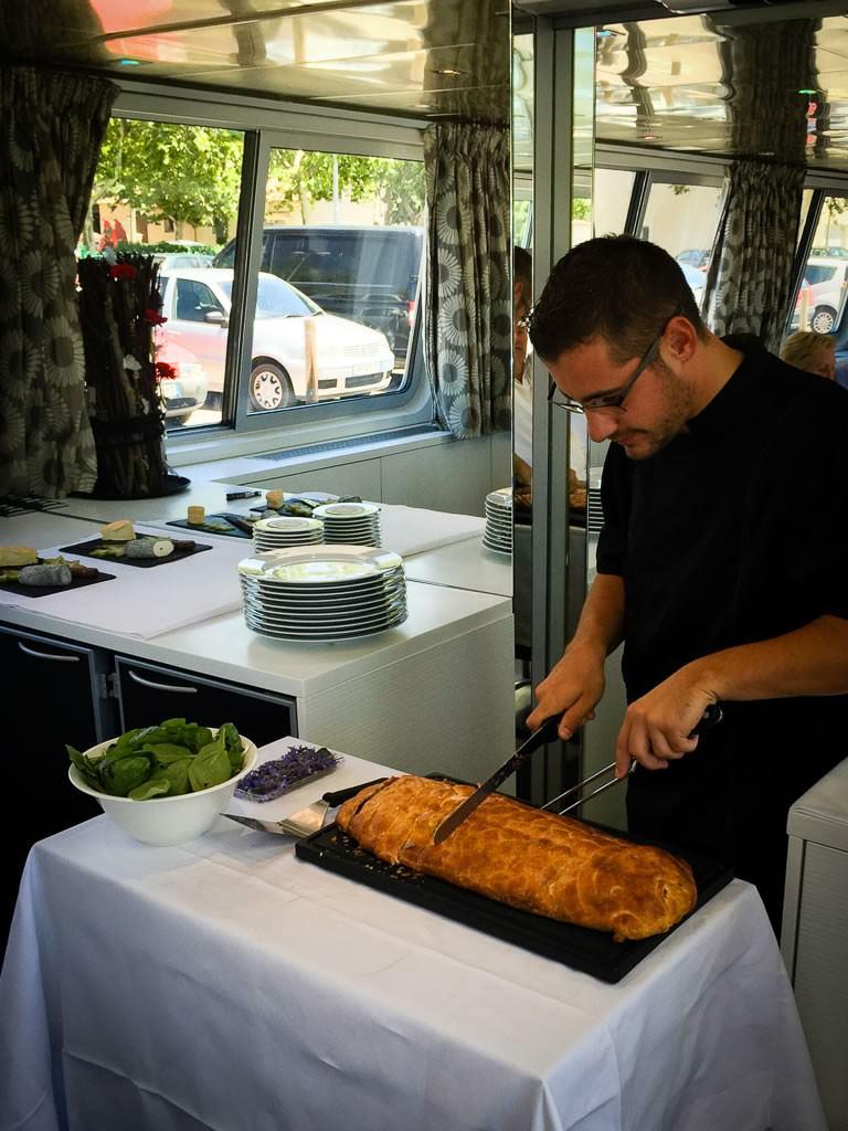 Chef Romain prepares a beautiful salmon dish. ©2015 Ralph Grizzle