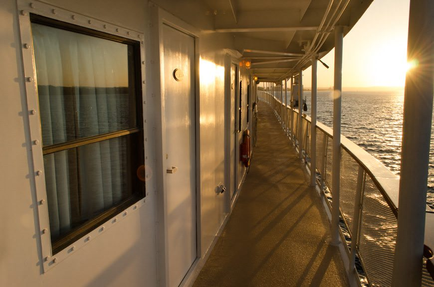 Strolling the decks of the S.S. Legacy as the sun goes down once again. Photo © 2015 Aaron Saunders