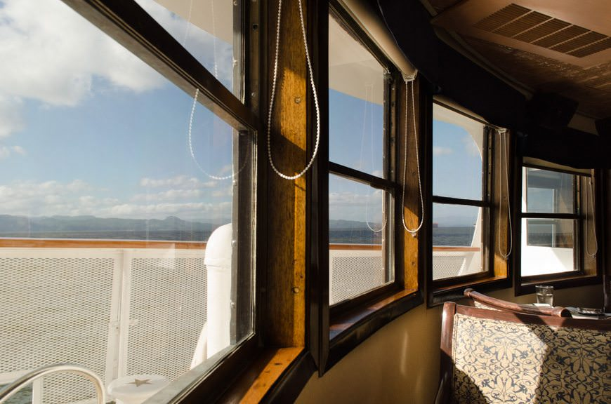 Back onboard the S.S. Legacy, flanked by the beautiful windows in the Lounge. Photo © 2015 Aaron Saunders