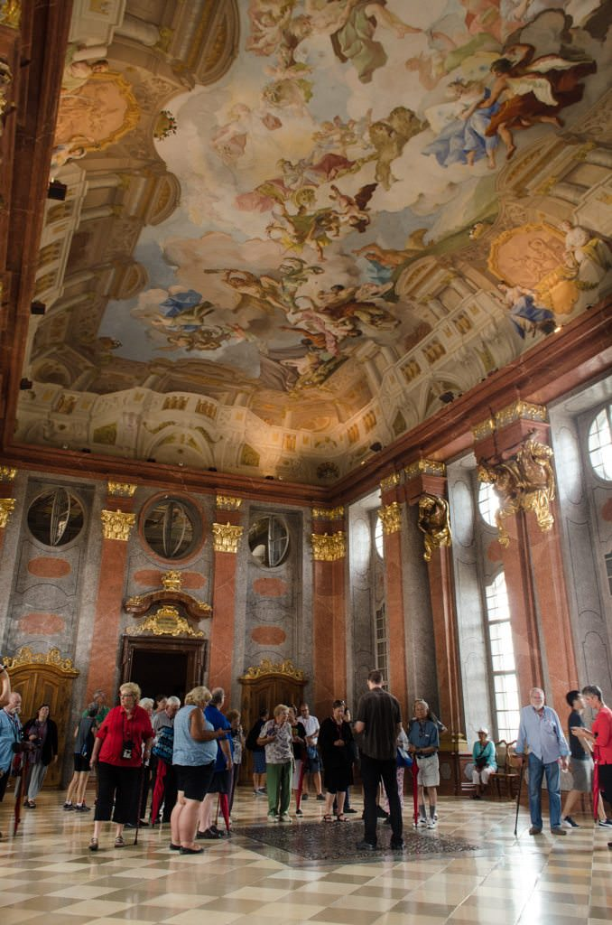 Melk Abbey's baroque opulence. The ceiling isn't really curved, though. Like so much of Melk Abbey, a trompe l'oeil, or illusion, has been employed. Photo © 2015 Aaron Saunders