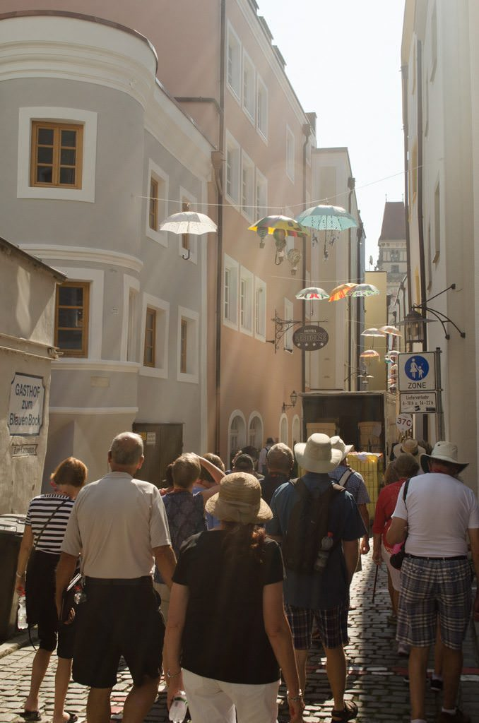 Strolling Passau's Art District. The umbrellas are part of an art installation that will remain up until Christmas, when they are auctioned off with the proceeds going to charity. Photo © 2015 Aaron Saunders