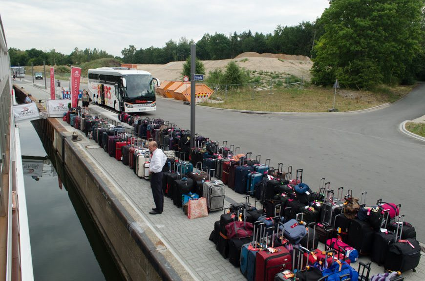 Viking VIdar's Hotel Manager Thomas looks over the sea of luggage that the crew brought off Viking Vidar in order to transfer us to Viking Lofn in Passau to get around a stretch of low water on the Danube. Photo © 2015 Aaron Saunders