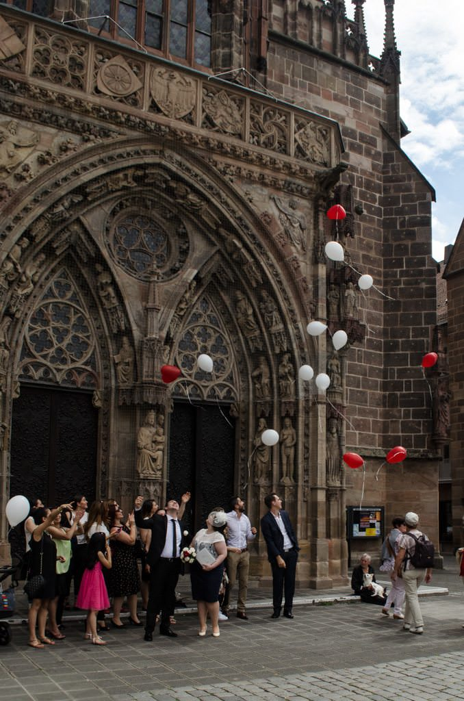 Back in the fresh air, a positive sign: another wedding party, this time in front of the Frauenkirche. Photo © 2015 Aaron Saunders