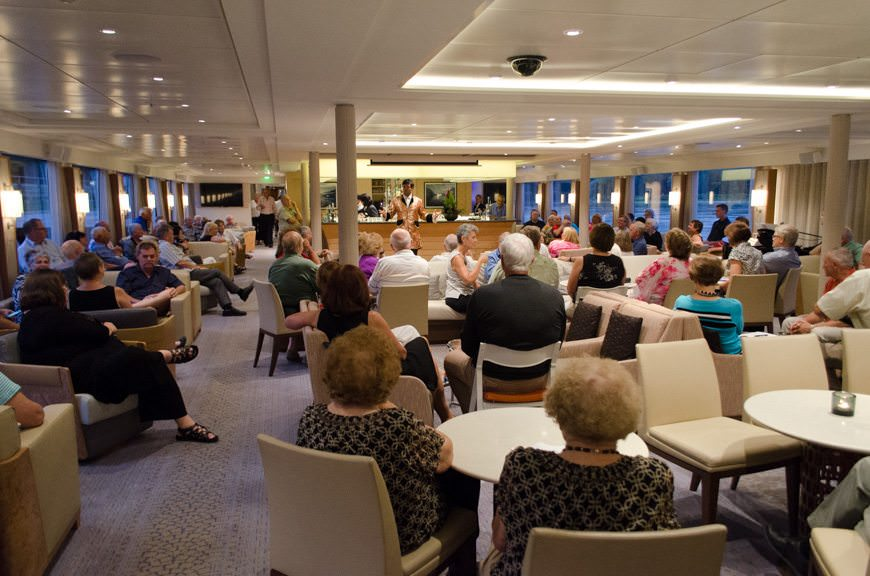 Guests gather for local entertainers who came aboard Viking Vidar in the Viking Lounge. Photo © 2015 Aaron Saunders