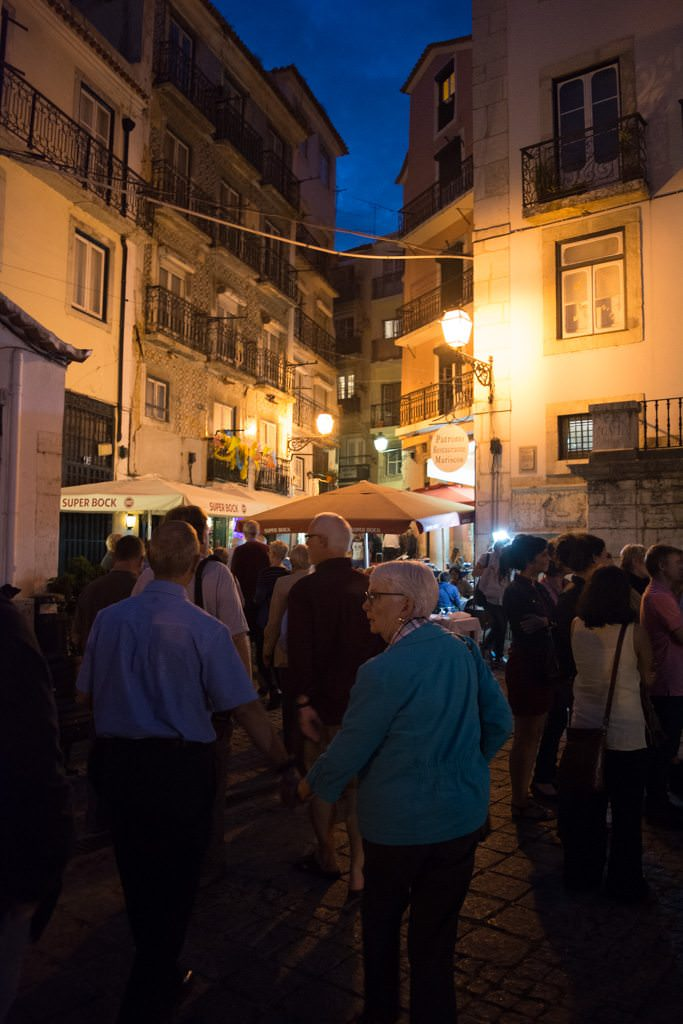 Guests stroll back through the historic streets of Lisbon as our first full day of touring in Portugal with Viking River Cruises comes to a close. Photo © 2015 Aaron Saunders