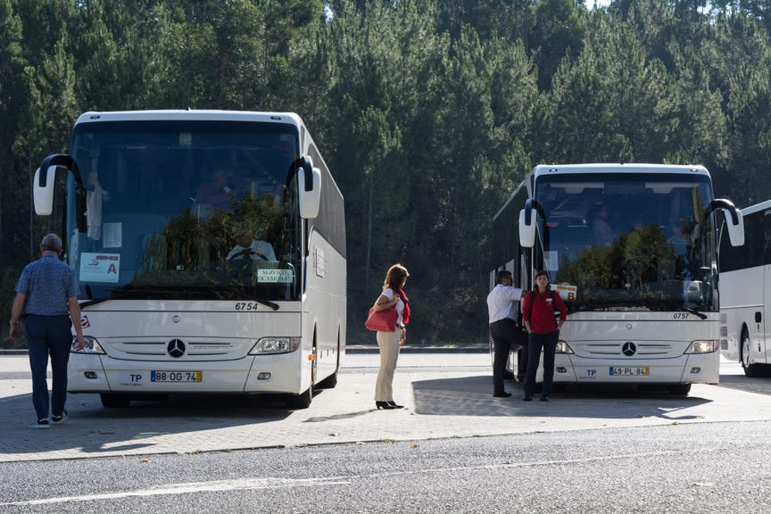Coaches await the return of their guests as we continue our journey to Coimbra and Porto. Photo © 2015 Aaron Saunders
