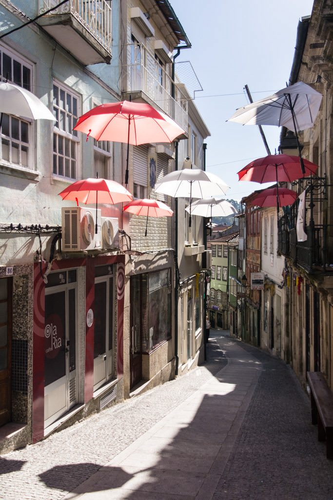 Umbrellas line a street in Lamego, Portugal. Photo © 2015 Aaron Saunders