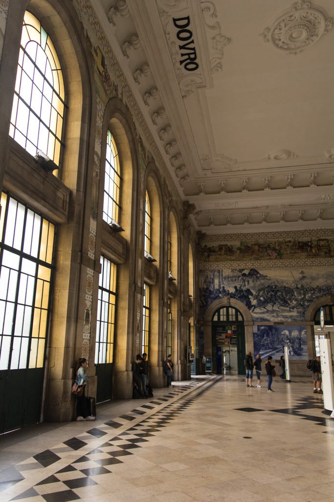 Inside Porto Central Station, with its impressive murals in the arrivals hall. Photo © 2015 Aaron Saunders