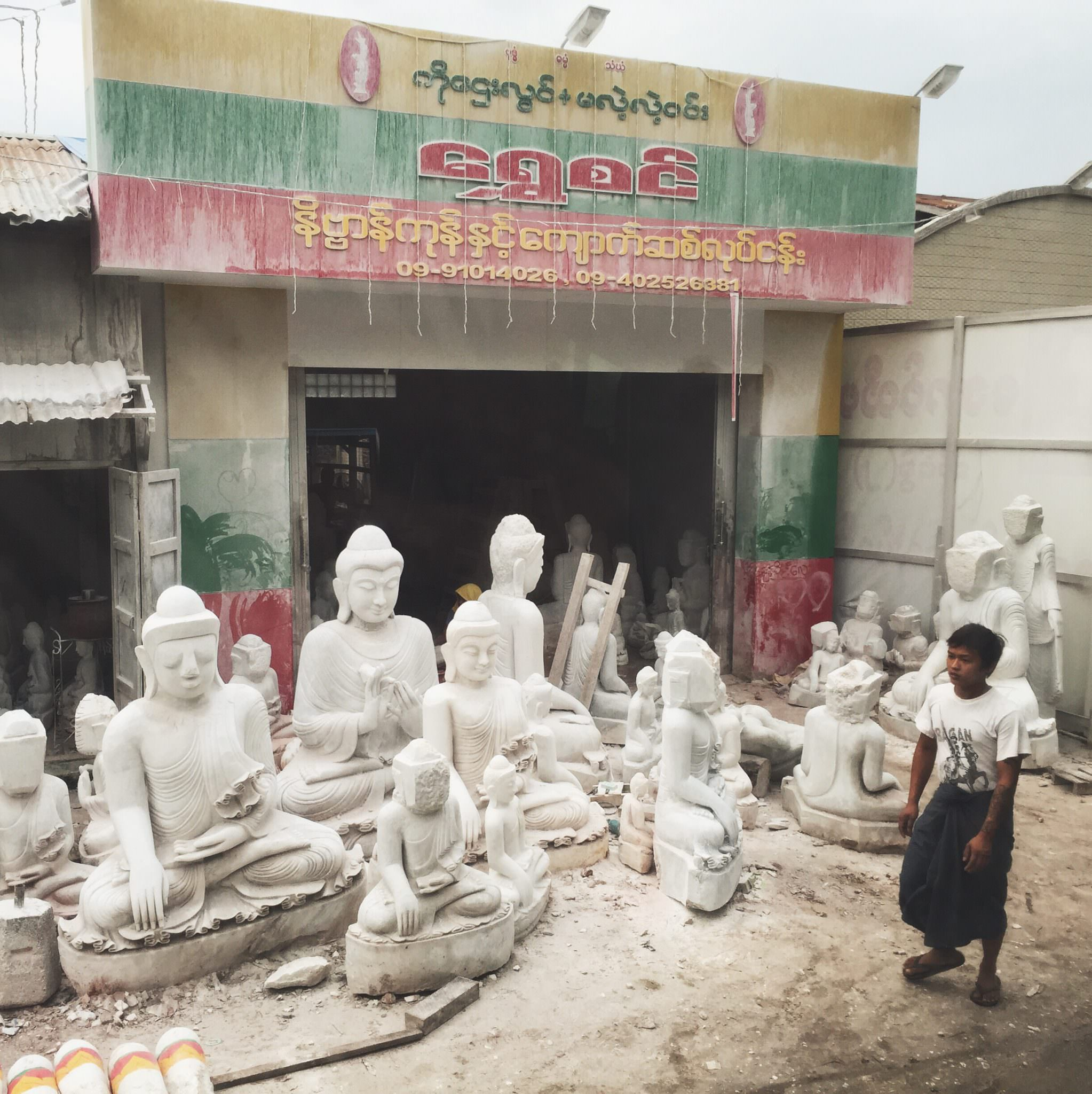 Do you see the Buddha statues with square faces? They are waiting for a master carver, the only person who is allowed to complete the sacred face. © 2015 Gail Jessen