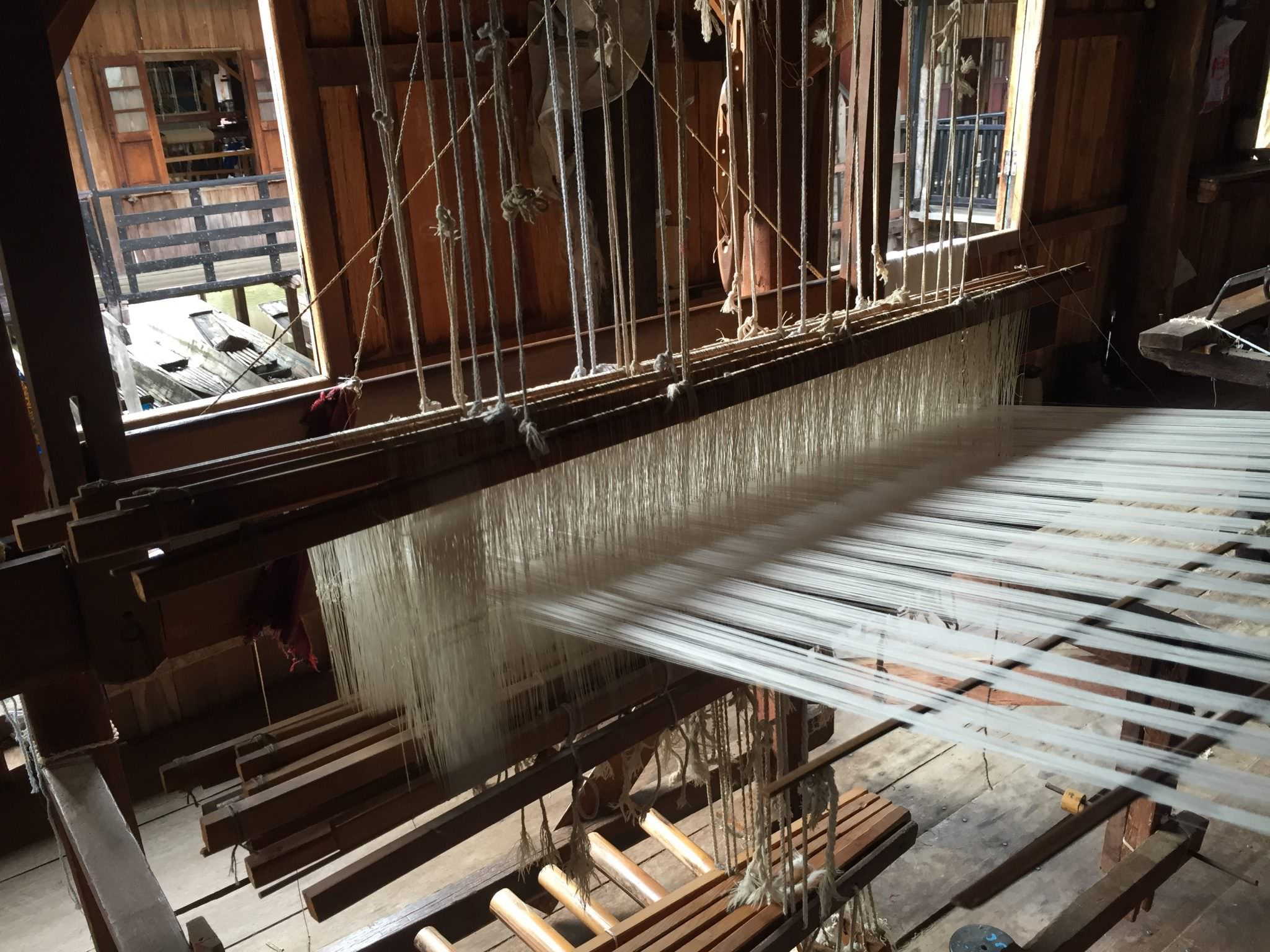 The clacking noise of manual, wooden looms was rhythmic and hypnotic. © 2015 Gail Jessen