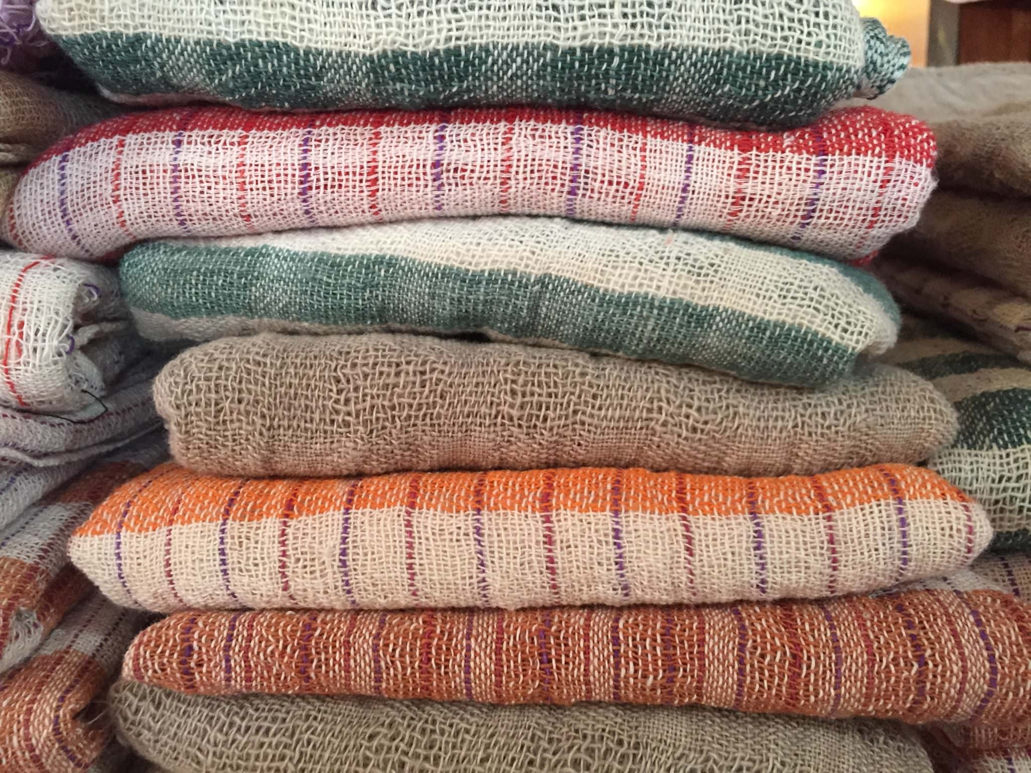Row upon row upon row of unique scarves waiting for you to come buy one! © 2015 Gail Jessen
