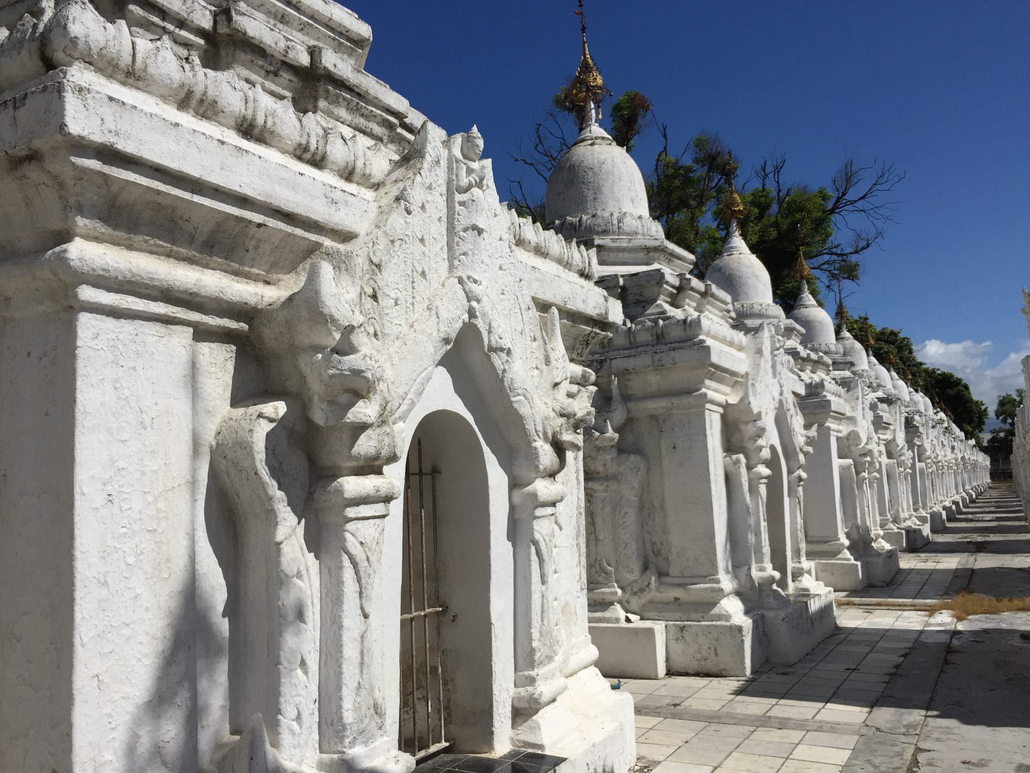 Row after row after row of stupas housing individual book pages at the Kuthodaw Pagoda complex. © 2015 Gail Jessen
