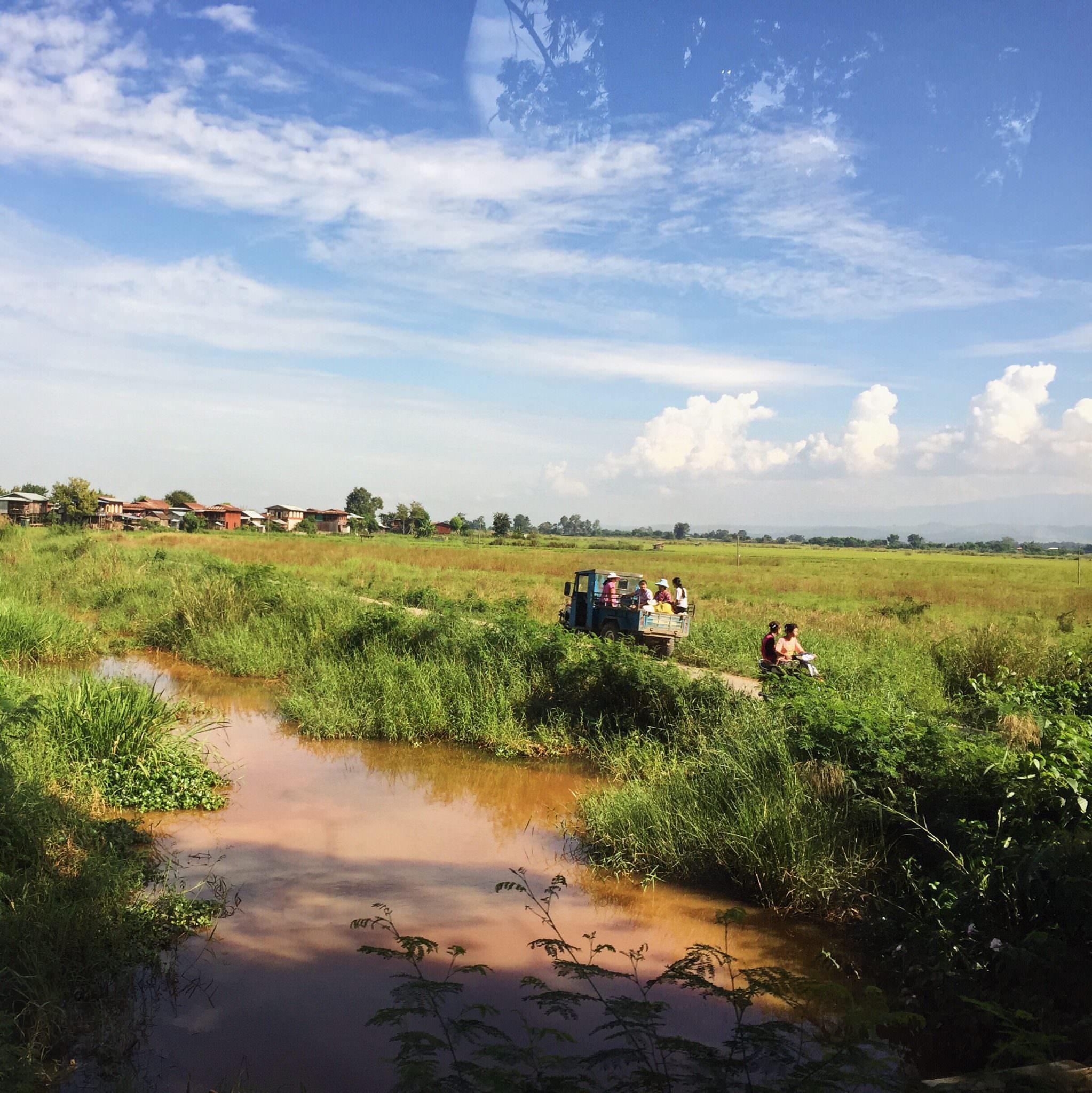 Burmese public transportation makes its way through the countryside. © 2015 Gail Jessen