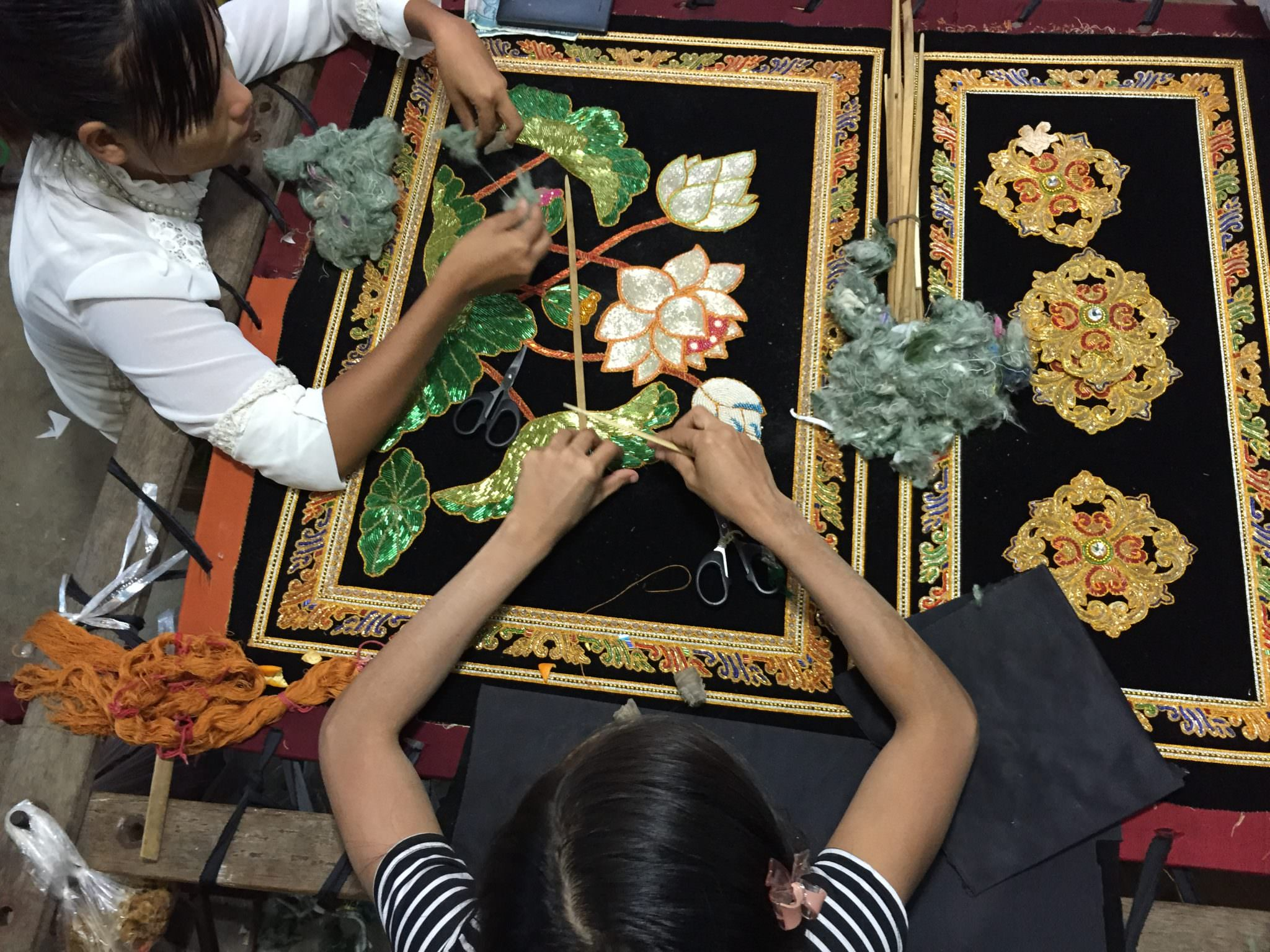 A Burmese kalaga is a decorative, embroidered cloth. They are unique in their design with sequins, 24 carat gold thread, and raw cotton shoved under the patterns to create 3D images. © 2015 Gail Jessen