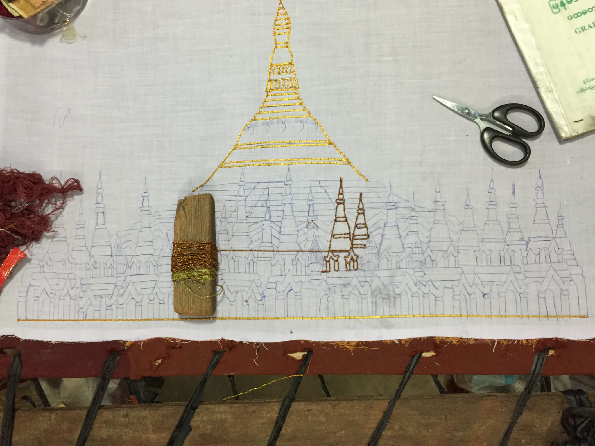 Detail of a kalaga in progress. Surprising to no one, this canvas will transform into a gold stupa. © 2015 Gail Jessen