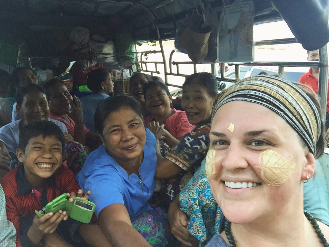 """""""THANAKA! THANAKA! HAHAHA..."""" - A taxi stuffed with hysterical Burmese people! By far one of my favorite memories. © 2015 Gail Jessen"""