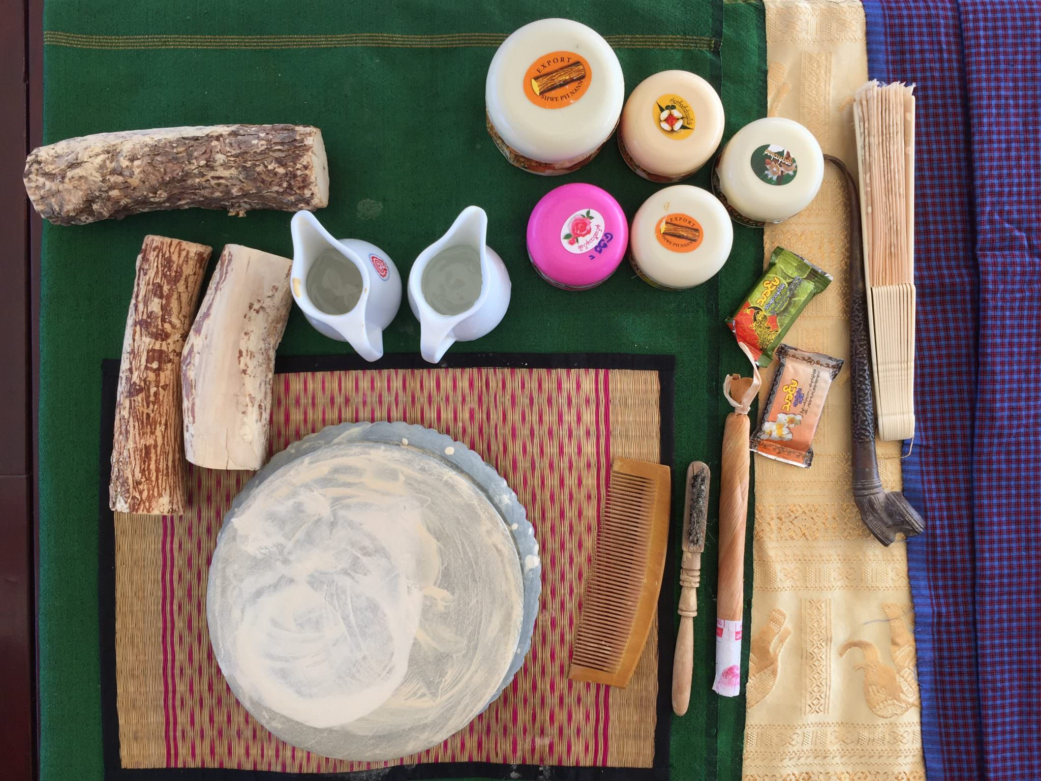Stumps of the thanaka tree are set for our demonstration on the mysterious beauty cream. © 2015 Gail Jessen