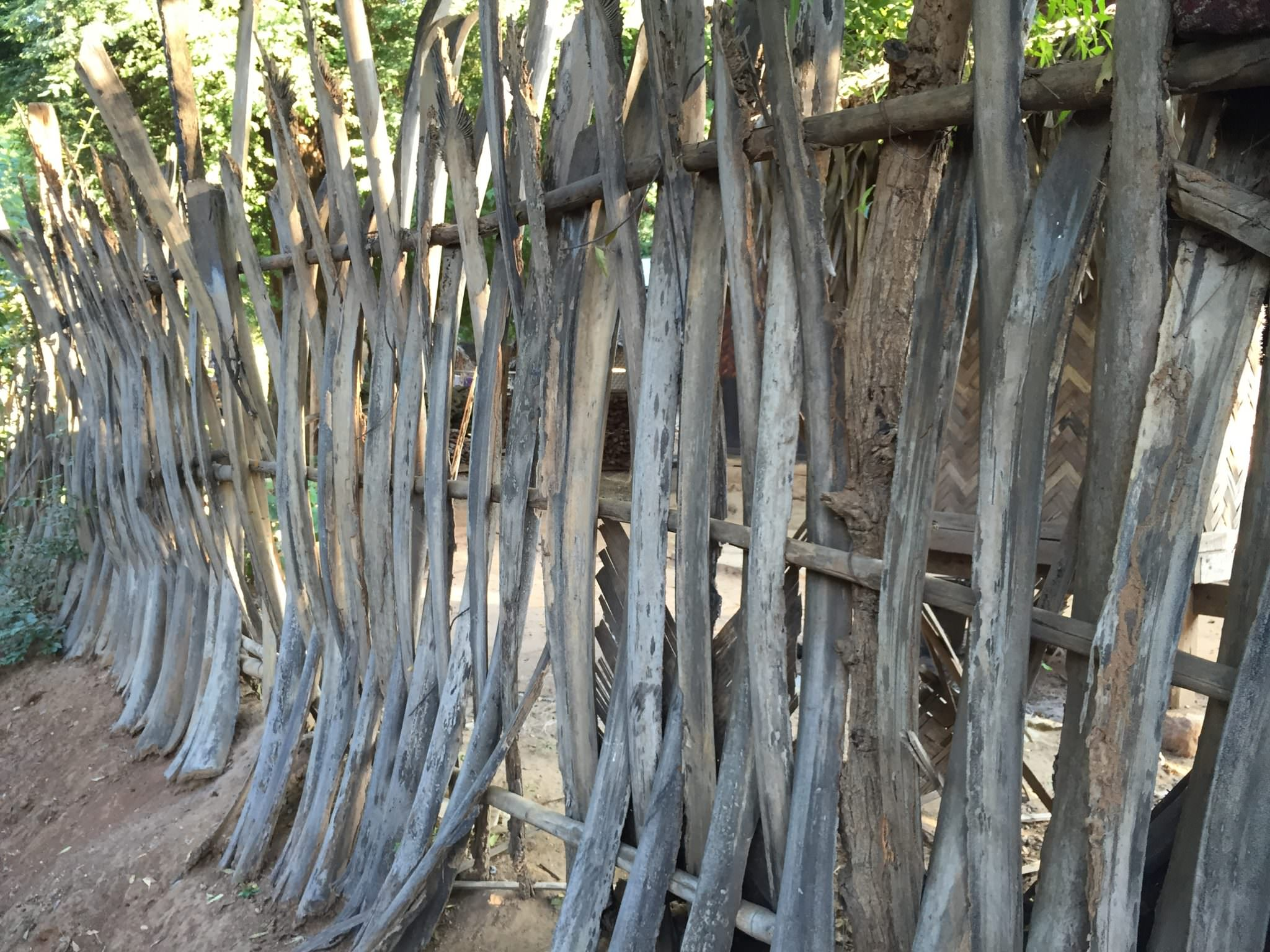 Palm fences lining every communal village street have a beautiful, sculptural design. © 2015 Gail Jessen