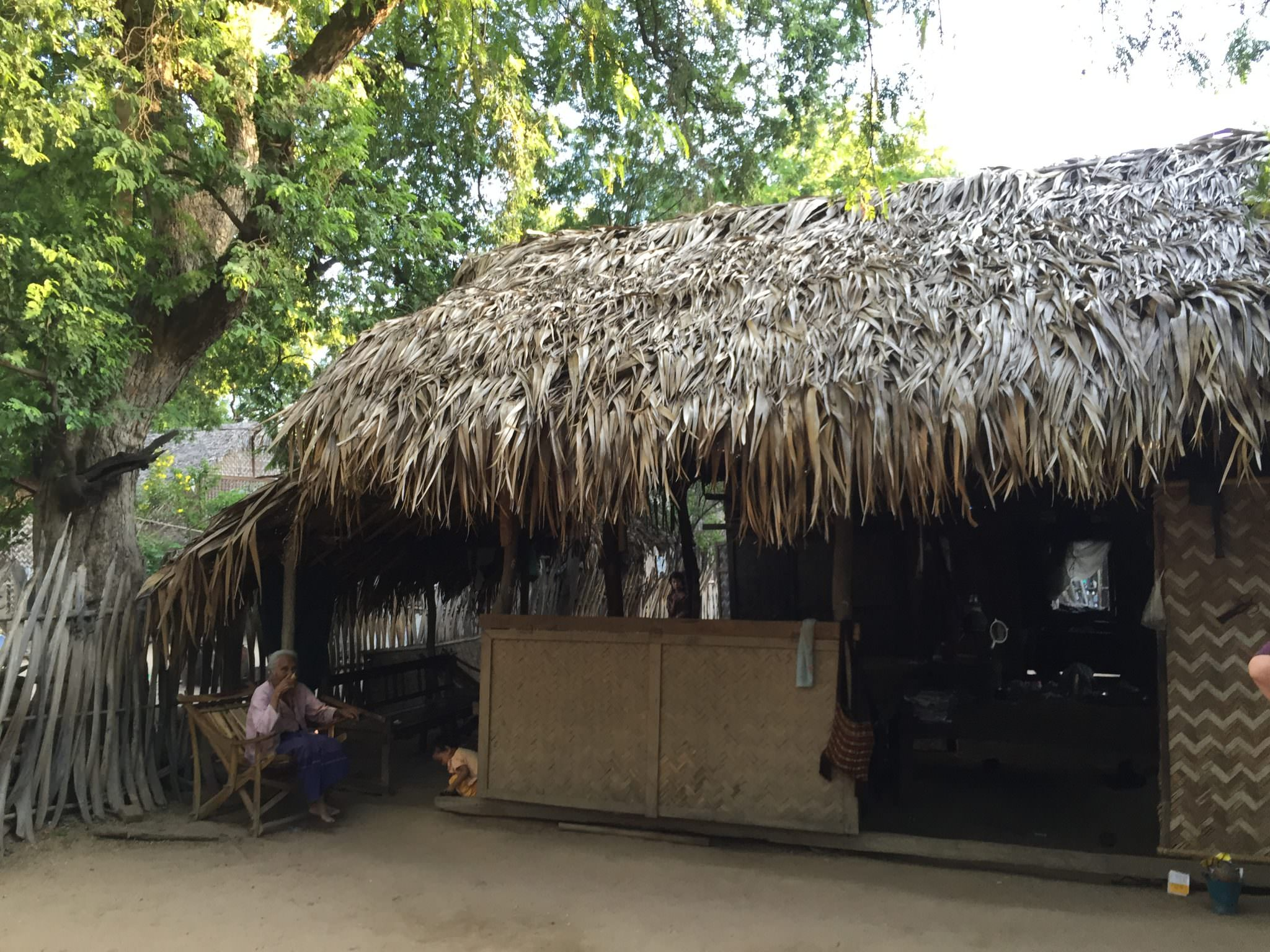 Every home looked the same, varying only in size. Thatched roofs, woven bamboo siding, no electricity or running water. © 2015 Gail Jessen