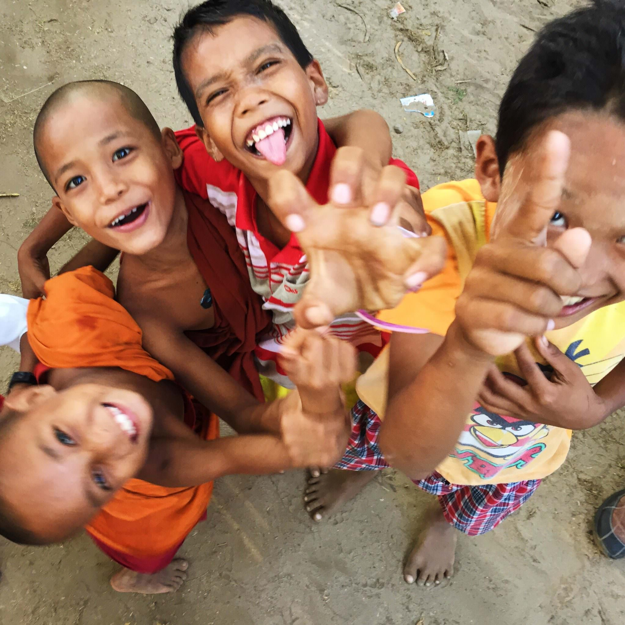 Children in Ohn Ne Choung going nuts to see themselves in my iPhone selfie screen. © 2015 Gail Jessen