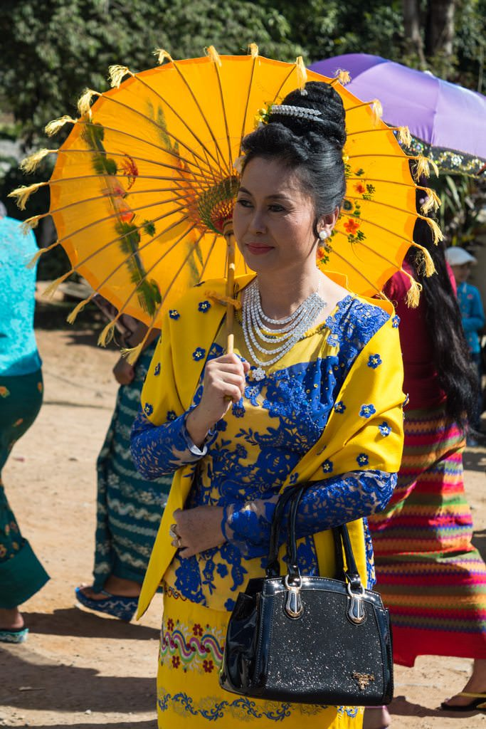 Many women wore the beautiful and traditional ceremonial dress of Myanmar...Photo © 2015 Aaron Saunders