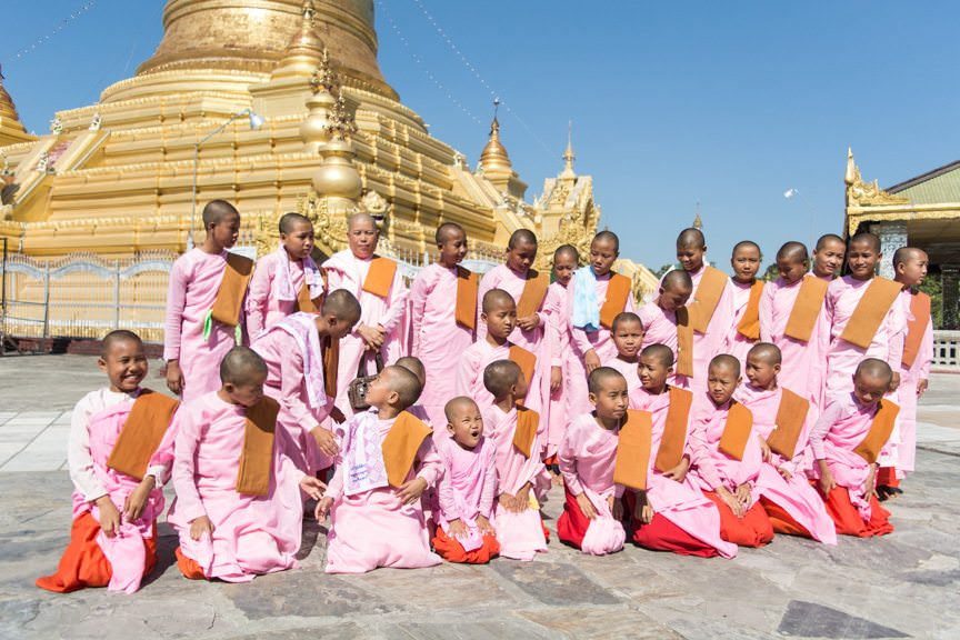 Young Buddhist monks pose for us...Photo © 2015 Aaron Saunders
