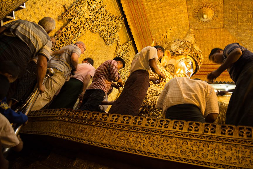 Men are allowed to directly pay respects to Buddha...Photo © 2015 Aaron Saunders