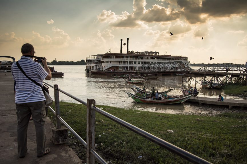 Before traveling to Shwedagon Pagoda, we stopped first for a panoramic vista of the riverfront in Yangon. Photo © 2015 Aaron Saunders