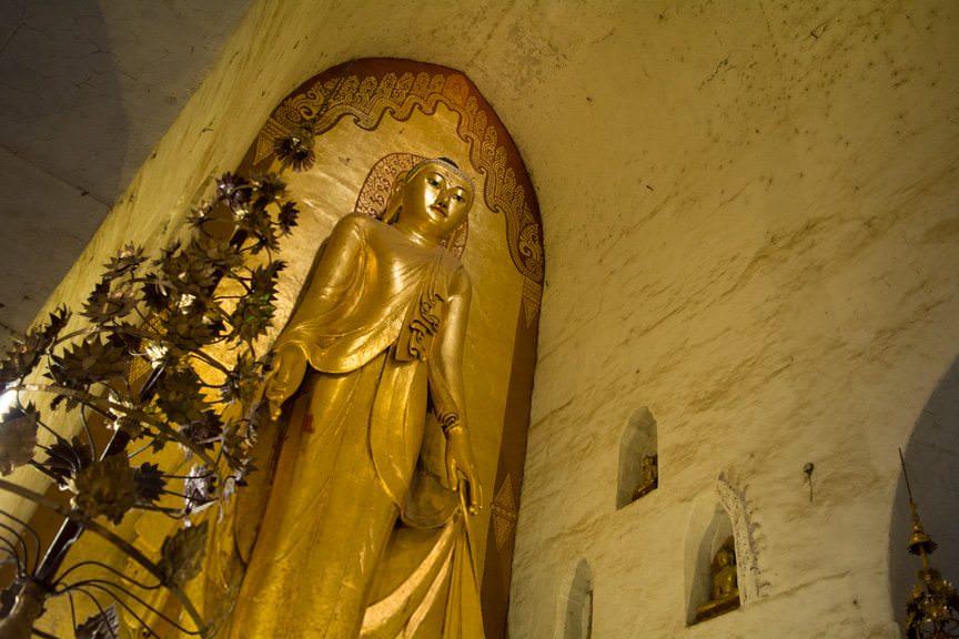 Inside Ananda Paya. Buddha is displeased...or is he? Photo © 2015 Aaron Saunders