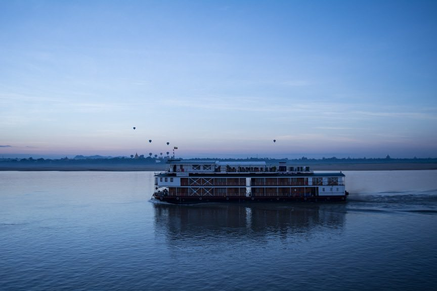 Another Pandaw river cruise ship passes us - at a very photographic moment! Photo © 2015 Aaron Saunders