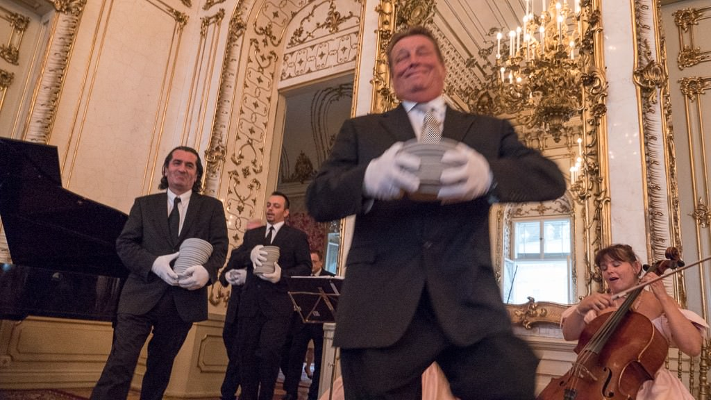 Dancing waiters set a jovial tone during our dinner with a princess in a Viennese palace. © 2015 Ralph Grizzle