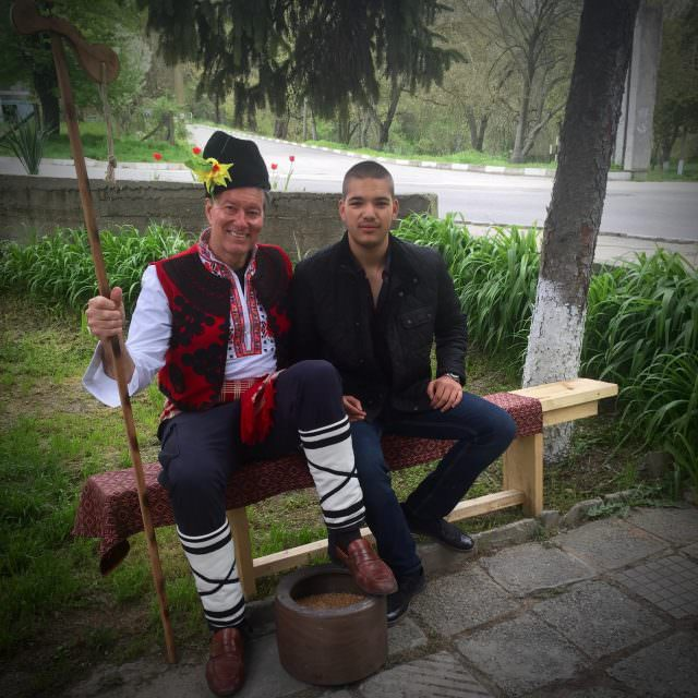 I got a chance to try on a Bulgarian costume. Seated with 17-year-old Deyan who translated for me and showed me around Alfatar. © 2016 Ralph Grizzle