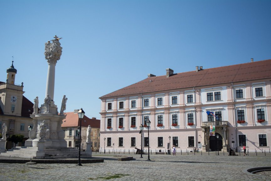 Osijek's historic Old Town square. The monument to the left is a recreation; the original was destroyed in 1992. Photo © 2016 Aaron Saunders