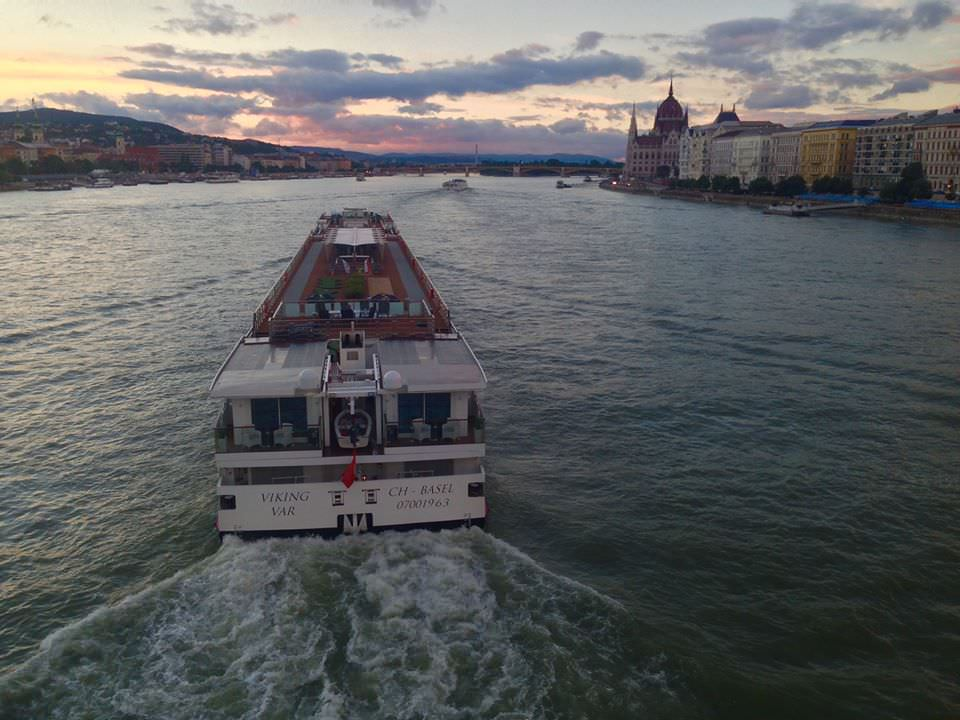 Viking River Cruises' Viking Var sails under the Chain Bridge in Budapest at sunset. Photo ©  2016 Aaron Saunders